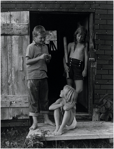 Three children in door, 1964©Olive Pierce. All Rights Reserved